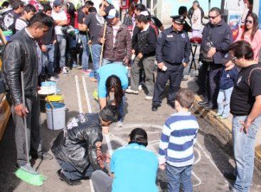 Fomentan cultura de legalidad con pinta de cajones para personas con discapacidad en Oaxaca