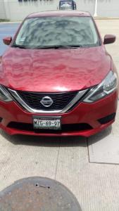 Nissan Sentra 2017, rojo y placas de circulación MZG-6997 del Estado de México.